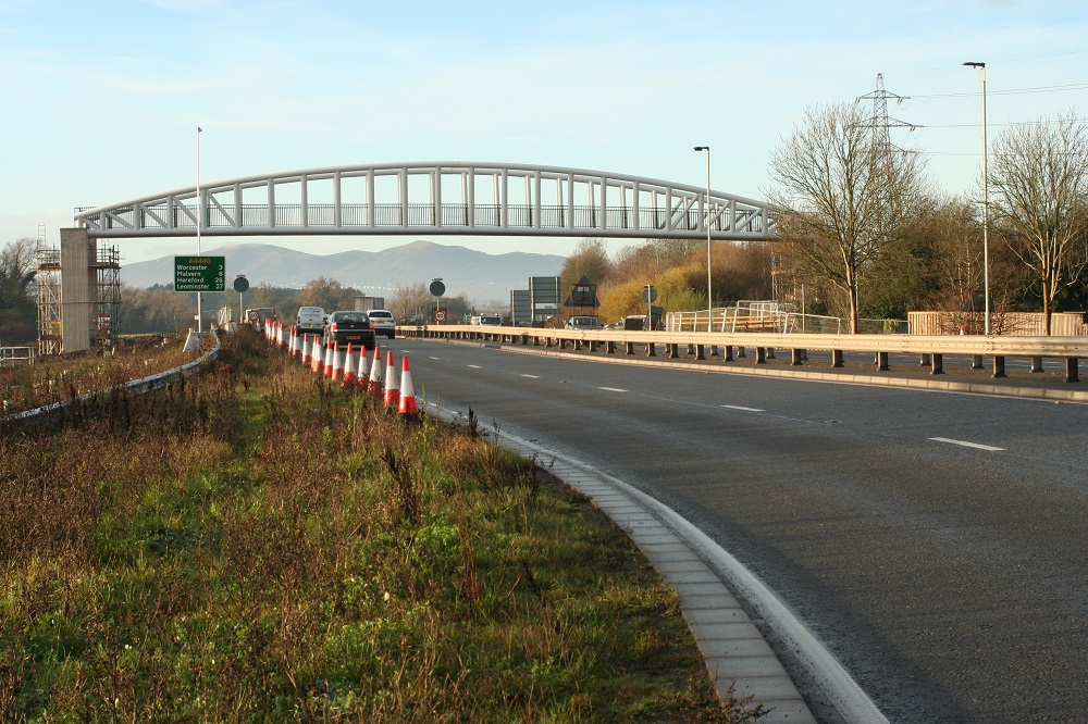 Bridge spanning Broomhall Way to link planned homes to park