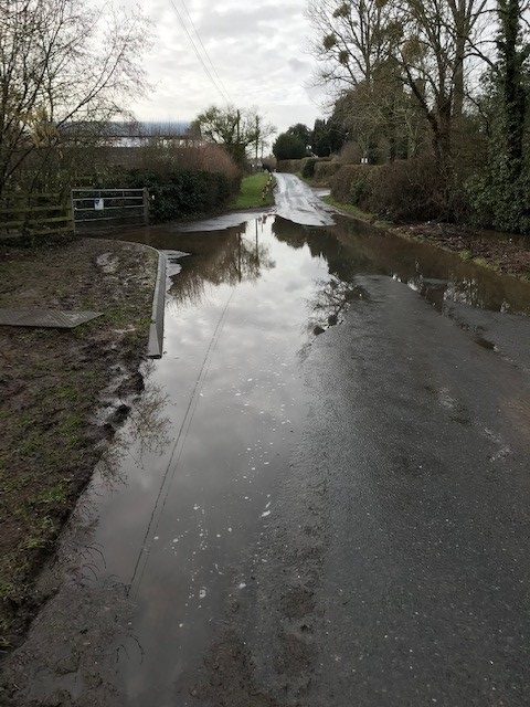 Floodwater 'cutting village in half' claims chairman
